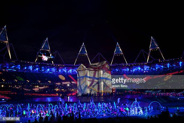 At the London Olympic games opening ceremony rehearsal a giant house is erected on the stage on to which multiple images are projected including a...