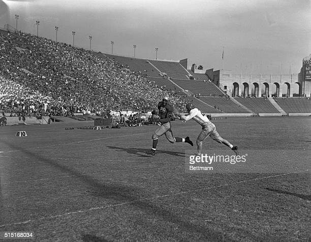 At the Los Angeles Coliseum UCLA left halfback Jackie Robinson scoring the first touchdown for the Bruins against Southern California Bob Robertson...