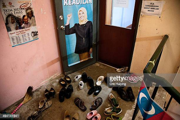 At the Malaysian opposition party Parti Keadilan Rakyat office in Lembah Pantai residents await to speak to their Member of Parliament Nurul Izzah...