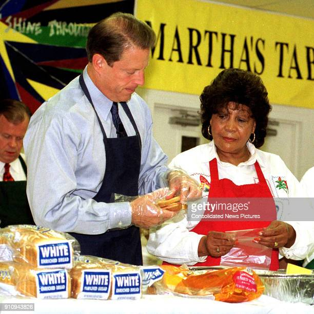 At the Martha's Table volunteer center US Vice President Al Gore and the center's Director of Operations Olivia Ivy both in chef's aprons prepare...