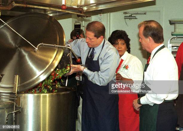 At the Martha's Table volunteer center US Vice President Al Gore pours vegetable ingredients into a commercial soup pot Washington DC October 15 1999...