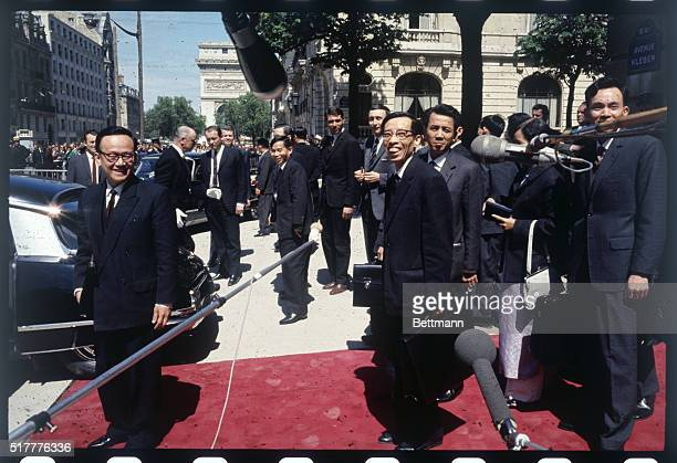 At the May 13 1968 session of Paris peace talks North Vietnamese representative Nguyen Thanh Le appears with entourage outside the Conference Building
