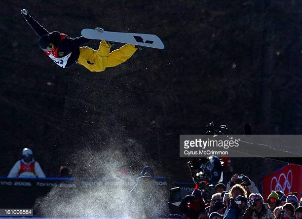 At the mens Winter Olympic snowboard half pipe contest Swedish boarder Stefan Karlsson arches over the crowd as he soars high above the pipe.
