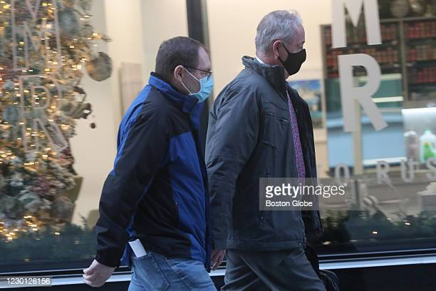At the Moakley Federal Courthouse, former sergeant William W. Robertson of Westborough, left, leaves the Moakley Federal Courthouse in Boston on Dec....