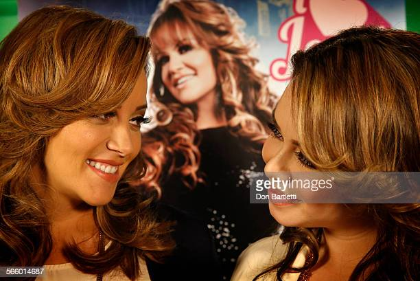 CITY CA At the mun2 network office Rosie Rivera left the late singer Jenni Rivera's sister and Janney Chiquis Marin Jenni's daughter with a poster of...