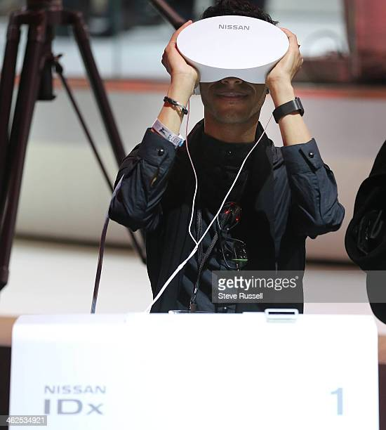 DETROIT MI JANUARY 13 At the Nissan booth media use the Nissan IDx virtual reality to design a car info collected goes into future designs at the...