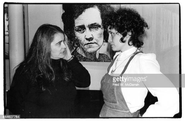 At the Noho Gallery American feminist activist author and artist Kate Millett talks with an unidentified woman New York New York February 1 1978 They...