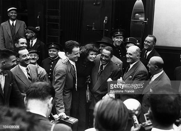 At the Northern Train Station, Boris VIAN and CHRISTOBINE, , a regular of the Saint-Germain-des-Pres club Tabou, greet the musician and composer Duke...