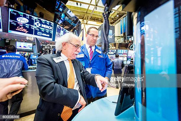 At the NYSE Euronext Stock Exchange floor specialists Peter M Tuchman with Quattro Securities and Anthony M Matesic with Barclays start trading again...