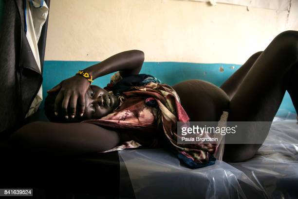 At the Nyumanzi maternity clinic a woman deals with labor pains about to give birth to her first child The Onward Struggle A refugee crisis in Uganda...