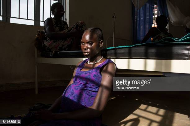 At the Nyumanzi maternity clinic Maria Adol age 20 deals with labor pains about to give birth to her first child The Onward Struggle A refugee crisis...