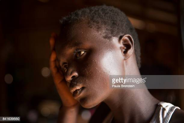 At the Nyumanzi transit camp Esther Ababiku is one of the many girls who lost her parents forced to flee on her own unaccompanied and vulnerable to...