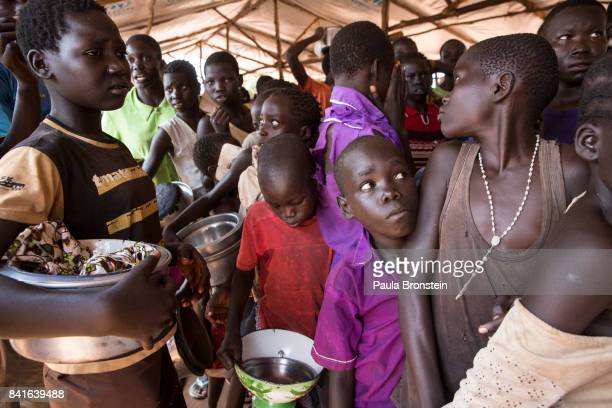 At the Nyumanzi transit camp refugees line up for hours to receive a hot meal from World Food Program The Onward Struggle A refugee crisis in Uganda...