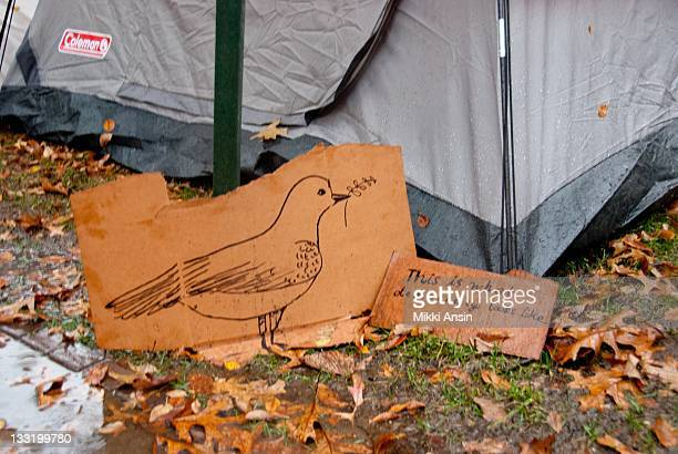 At the Occupy Harvard protest students set up a tent village in the rain on the campus of Harvard University with a peace dove sign that reads 'This...
