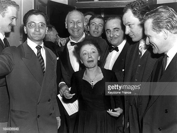 At the Olympia in Paris a tired Edith PIAF poses surrounded by her musicians after her singing tour