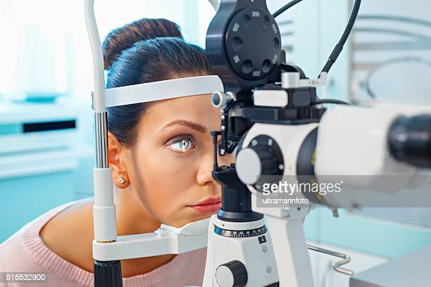 at the optician   ophthalmology   doctor ophthalmologist   optometrist medical eye examination - optometry stock pictures, royalty-free photos & images