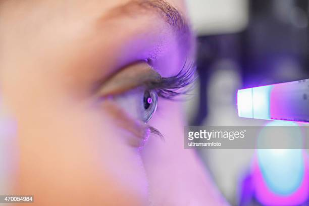 at the optician   ophthalmology    optometrist medical eye examination - optometry stock pictures, royalty-free photos & images