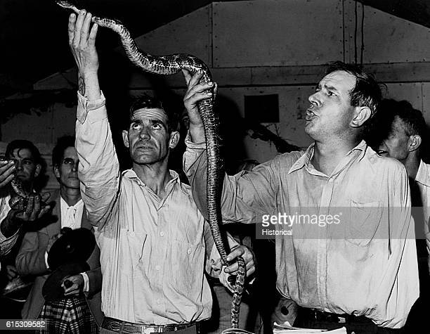 At the Pentecostal Church of God in Lejunior Kentucky believers handle poisonous serpents to demonstrate their faith in God 1946 | Location Lejunior...