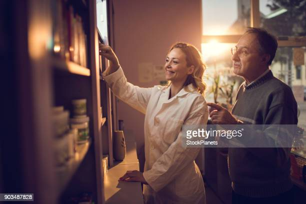 at the pharmacy - homeopathic medicine stock photos and pictures