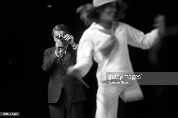 At the Polaroid Corporation annual meeting President Edwin H Land demonstrates his company's Polavision instant movie camera with the help of a...