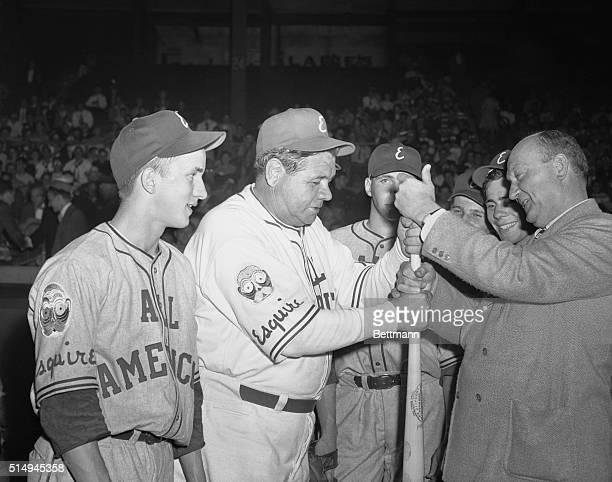 At the Polo Grounds before the start of the Big East-West Esquire All American Boys ball game tonight , Babe Ruth Yankee home run king and manager of...