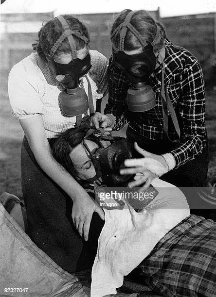 At the practical exercise of the school group of the austrian Luftschutzbundes some school girls are trying to help a girl who is gassed Austria...