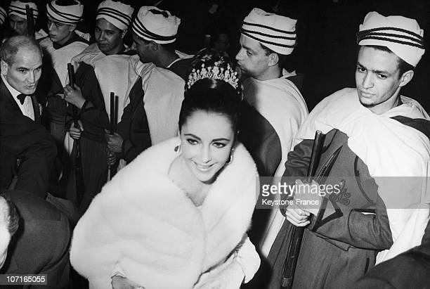 At the premiere of the film 'Lawrence of Arabia' at the Theatre des Champs Elysees Elizabeth Taylor passes a hurdle 'bedouin' on March 16 1963 in...