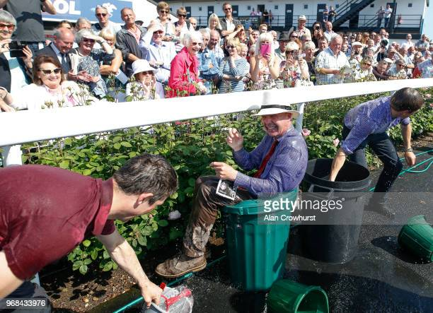 At The Races presenter Luke Harvey finds himself in a bin full of water as the Andrew Thornton retirement presentation gets out of hand at Uttoxeter...