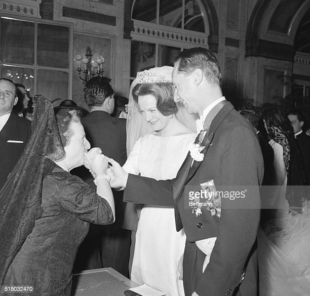 At The Reception Rome Italy Unidentified Spanish lady kisses the hands of the bride and groom Princess Irene of the Netherlands and Spanish Prince...