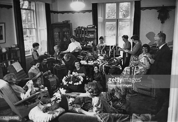 At the rectory of Hinton St George a large party has gathered to make decorations for the upcoming village Coronation Carnival Somerset May 1953...