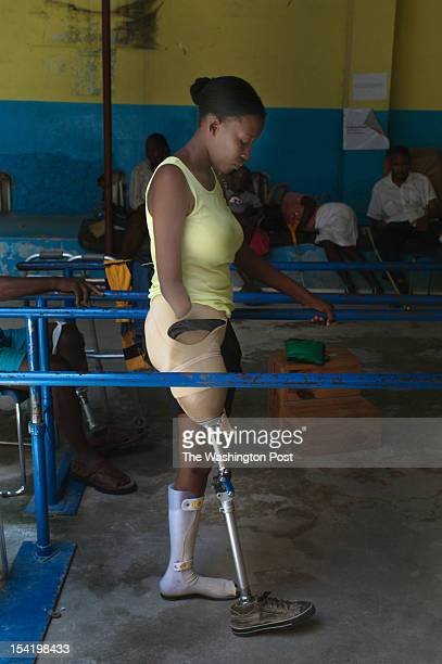 At the rehabilitation gym of Handicap International an NGO which is training Haitians to work with amputee victims Judette Jusme practices walking...