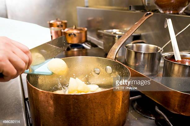 At the restaurant l'Ambassade d'Auvergne the chef Didier Desert prepares l'Aligot a french recipe from the Auvergne region with Cantal cheese served...