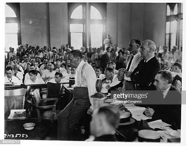 At the Rhea County Courthouse Clarence Darrow attorney for John Thomas Scopes waits with his defense team during the Scopes trial regarding the...