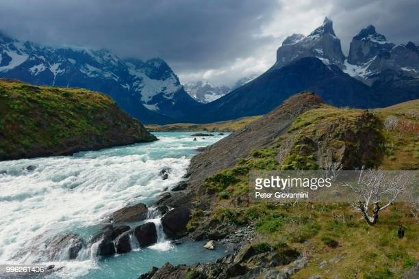 At the Salto Grande del Rio Paine, mountain peaks of Cuernos del Paine at the back, Torres del Paine National Park, province Ultima Esperanza, Chile