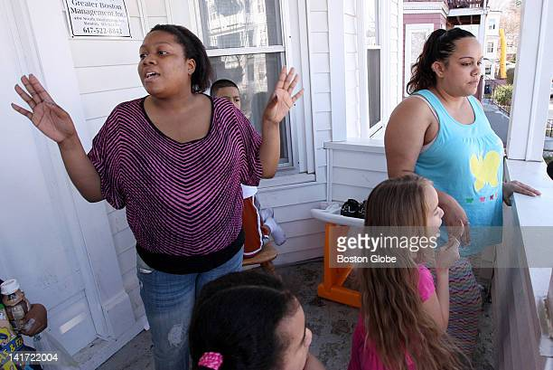At the scene of the crime on Woolson Street in Mattapan neighbors left to right Myriam Pierre and Felicita Cruz react to the news that the Mattapan...