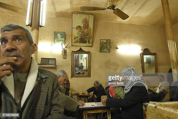 At the Sharia Raschid cafe patrons sit beneath a photo of Saddam Hussein although his name is rarely spoken in the cafe The Sharia Raschid cafe is a...