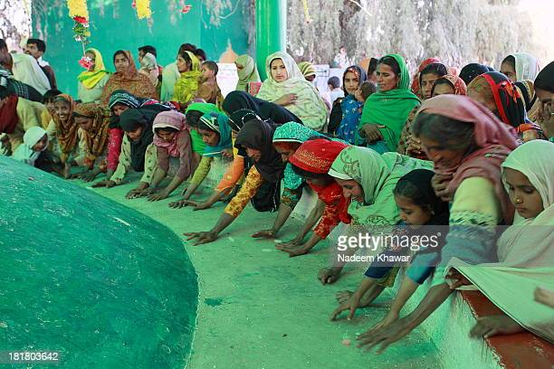 """At the Shrine of Chanan peer the festival held each year in March.People throw the dried sweet called """"Makhana"""" On the big grave wich have the shape..."""