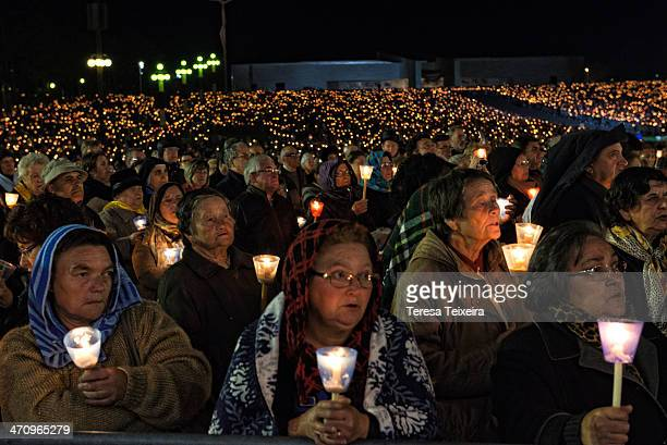 CONTENT] At the Shrine of Fátima on 13th October the anniversary date of the last apparition of Our Lady of Fátima Pilgrims are praying and holding a...