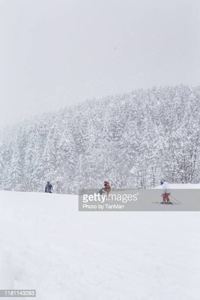 at the slopes. winter in niseko, japan. - winter sport stock pictures, royalty-free photos & images