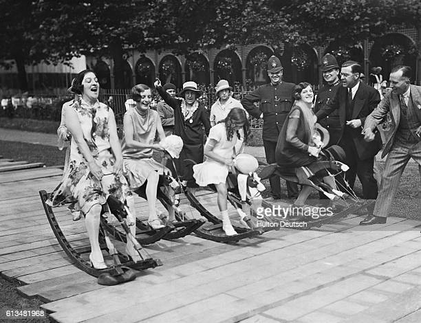 At the sound of the starter's orders wouldbe jockeys set off along a course of wooden planks during the Kinematograph Garden Party at Kew Gardens