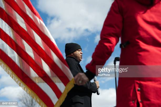 At the start of a protrump rally as the National Anthem is performed MC Erin Elmore holds a tip of the American flag in Bensalem PA on March 4th 2017...