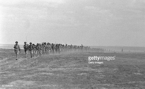 At the start of Israel's first occupation of this wartorn area invading Israeli infantry troops advance November 1 1956 on the southern Arab town of...