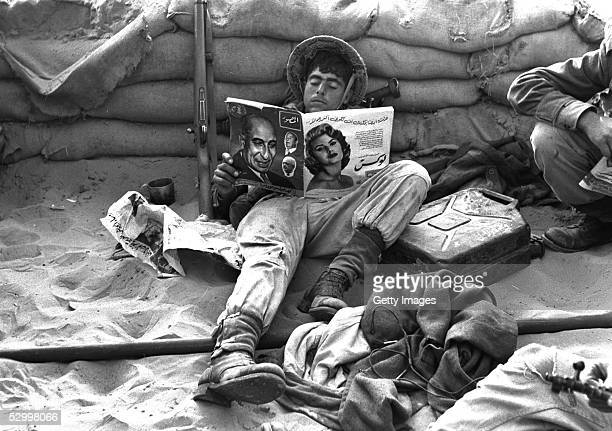 At the start of Israel's first occupation of this wartorn area an invading Israeli infantry trooper reads an Arabic magazine found in a captured...