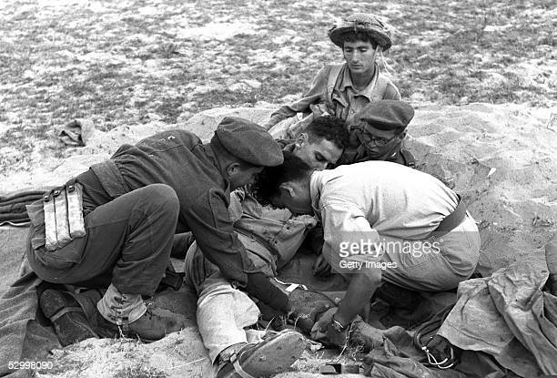 At the start of Israel's first occupation of this wartorn area Israeli army medics treat an Israeli soldier wounded in fighting November 1 1956 in...
