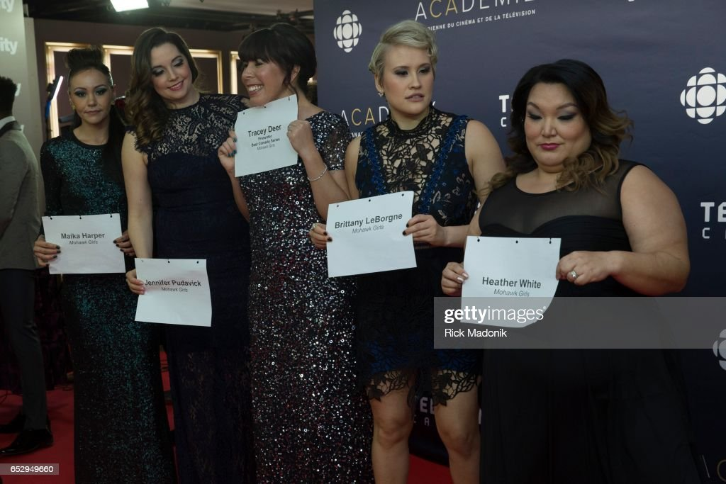 At the start of the red carpet for still photographers, some hold their name cards to make it easier for the photogs. Canadian Screen Awards red carpet at Sony Centre for the Performing Arts ahead of the show.
