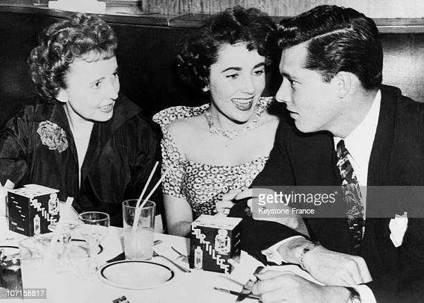 At the Stork Club film actress Liz Taylor and her fiance Conrad NHilton son of a wealthy hotel magnate and Liz's mother Sara on March 16 1950 in New...
