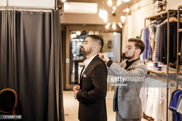 at the tailor shop - custom tailored suit stock pictures, royalty-free photos & images