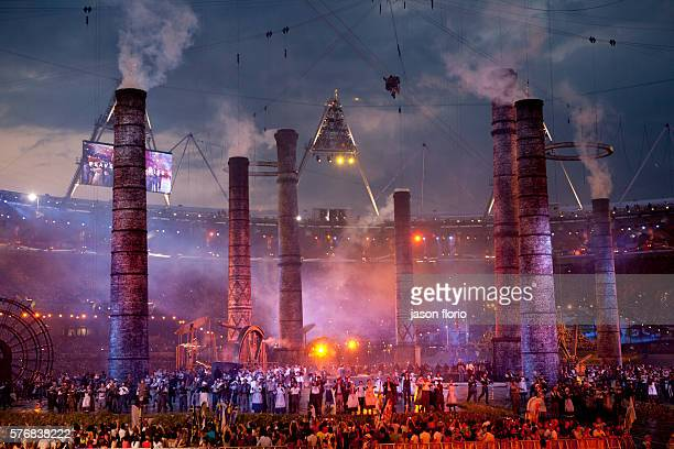 At the technical rehearsal of the opening of the London Olympicsa scene from Britain's industrial revolution is erected while hundreds of drummers...