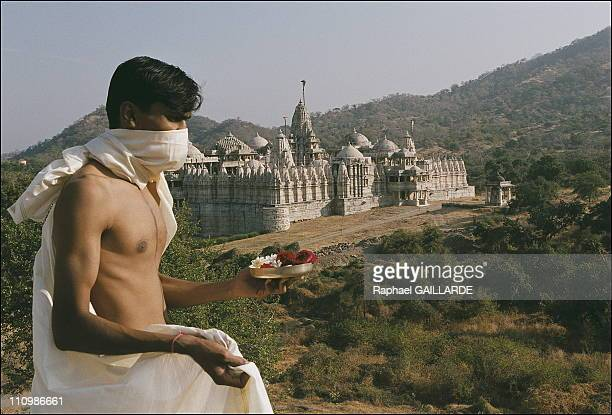 At the Temple of Adinath in Ranakpur 23yearold Jain pilgrim Saurin Shah prepares to make a ritual offering or puja of wild roses sandalwood paste...