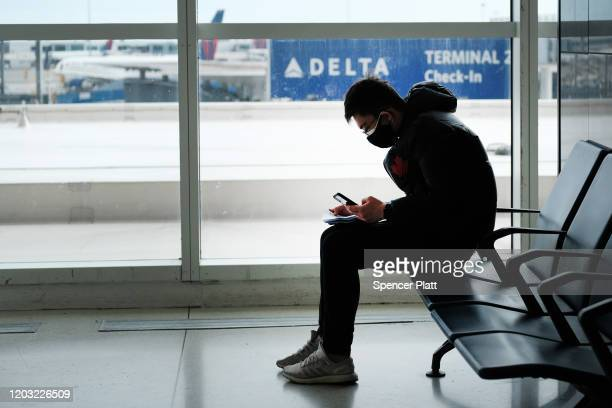 At the terminal that serves planes bound for China people wear medical masks out of concern over the Coronavirus at John F Kennedy Airport out of...